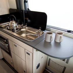 Kitchen work top surface extension