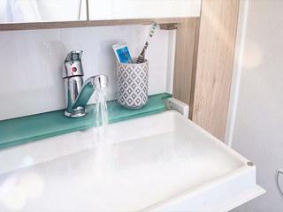 Fold away washroom basin