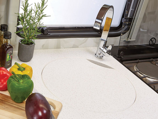 Kitchen sink with chopping board/cover